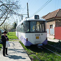 TIMISOARA, ROMANIA - APRIL 21:  A woman waits for the tram just few stops from the city centre  on April 21, 2013 in Timisoara, Romania.  Romania has abandoned a target deadline of 2015 to switch to the single European currency and will now submit to the European Commission a programme on progress towards the adoption of the Euro, which for the first time will not have a target date. (Photo by Marco Secchi/Getty Images)