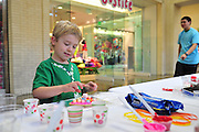 Members of Paint the World help kids decorate cookies as part of a fundraising event for Shared Housing North Park Mall on Sunday, February 10, 2013 in Dallas, Texas. (Cooper Neill/The Dallas Morning News)
