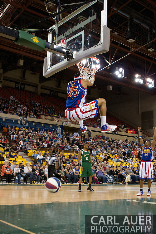 April 30th, 2010 - Anchorage, Alaska:  Harlem Globetrotter Prince Perez delivers a reverse dunk on Friday night at the Sullivan Arena.