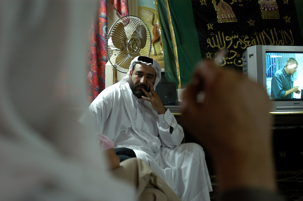 Jamal Kamel, the younger brother of Hussein and Saddam Kamel, Saddam Hussein's two sons-in-law, and nephew of Ali Hassan al-Majid, infamously known as Chemical Ali, at his home in Baghdad..Baghdad, Iraq. 30 May 2003..Photo © J.B. Russell