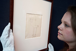 "© Licensed to London News Pictures. 21/03/2014. London, UK. A member of Sotheby's auction house staff adjusts 'untitled illustration of a bespectacled creature with clawed feet' (GB£3,600-4,800) a drawing by the late Beetles singer John Lennon, allegedly the piece that brought him to the attention of his future wife Yoko Ono, during the press view for a new sale at Sotheby's auction house in London today (21/03/2014). The auction, entitled ""You Might Well Arsk"", features original drawings and manuscripts by the singer from 1964-1965. Photo credit: Matt Cetti-Roberts/LNP"