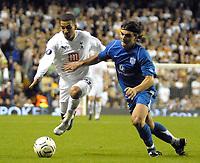Photo: Ed Godden/Sportsbeat Images.<br /> Tottenham Hotspur v Anorthosis Famagusta. UEFA Cup, First Leg. 20/09/2007. Spurs' Aaron Lennon (L), takes the ball past Costas Loumpoutis.