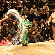 A Sumo throws salt into the ring before a bout  at the Ryōgoku Kokugikan in Tokyo during the grand tournament.<br />