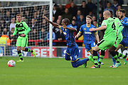 Charlie Clough fouls Tom Elliott of AFC Wimbledon during the The FA Cup match between AFC Wimbledon and Forest Green Rovers at the Cherry Red Records Stadium, Kingston, England on 7 November 2015. Photo by Stuart Butcher.