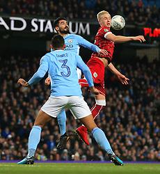 Hordur Magnusson of Bristol City wins a header above Ilkay Gundogan of Manchester City and Danilo - Mandatory by-line: Matt McNulty/JMP - 09/01/2018 - FOOTBALL - Etihad Stadium - Manchester, England - Manchester City v Bristol City - Carabao Cup Semi-Final First Leg