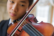 Samuel Wang plays his violin at his home in Medford, NJ, Friday, April 3, 2015.  Wang has earned his a place with the National Youth Orchestra of the USA for a second season. Photo by Bryan Woolston.