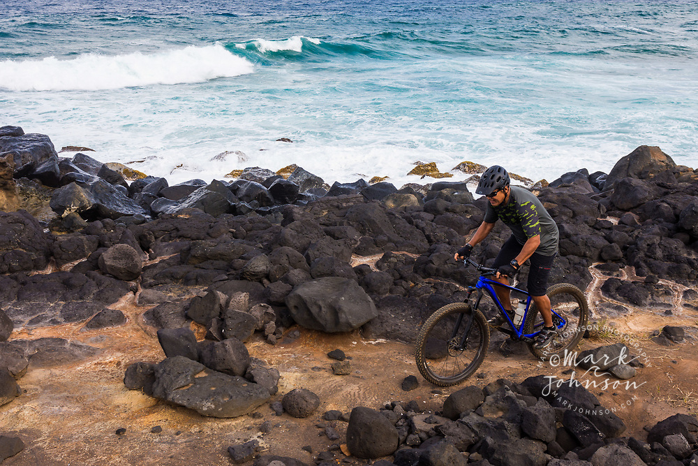 Mountain biking along the coast of Kauai, Hawaii