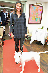 KATIE KEIGHT and her dog Snoop at a party hosted by Lulu Guinness and Daphne's to launch Lulu's Designer Dog Bowl and to mark Daphne's allowing dogs through it's doors, held at Daphne's, Draycott Avenue, London on 28th June 2016.