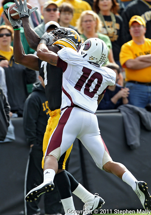 September 24, 2011: Iowa Hawkeyes wide receiver Marvin McNutt (7) pulls in a pass as Louisiana Monroe Warhawks cornerback Tim Taylor (10) defends during the first quarter of the game between the Iowa Hawkeyes and the Louisiana Monroe Warhawks at Kinnick Stadium in Iowa City, Iowa on Saturday, September 24, 2011. Iowa defeated Louisiana Monroe 45-17.