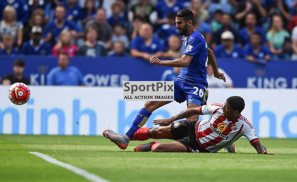 Riyad Mahrez gets his shot in despite the tackle from Patrick van Aanholt (c) Simon Kimber | SportPix.org.uk