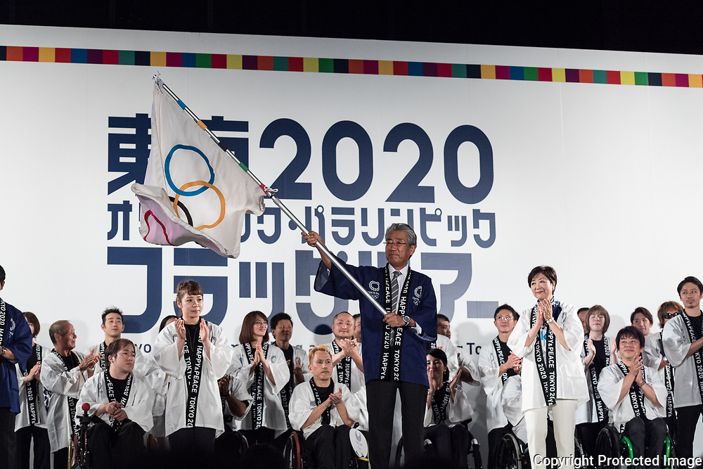 Tsunekazu Takeda, President of Japanese Olympic Committee (JOC) holds an olympic flag during the ceremony marking the 3 years to go to the Tokyo 2020 Olympics Games on July 24, 2017 at the Tokyo Metropolitan Government Building, Tokyo, Japan. 24/07/2017-Tokyo, JAPAN
