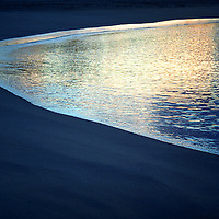 Abstract Beach Sunrise with colourful water reflection, County Kerry, Ireland / ws001