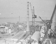 """AMAZING Photo Film discovered Documenting Work In Chernobyl <br />Chernobyl worker Aleksandr Shubovskiy captures rare images <br /><br />During one of the days in 1979-80, when the erection of Ventilation Stack VT-2 common for the third and fourth (not existed at that time) Chernobyl NPP Units was coming to the end, Aleksandr Shubovskiy, who was working within a combined installation crew in a company named """"Spetsenergomontazh"""", arranged with the colleagues a small photo session on his own,They had their pictures taken.<br /><br />The author processed the film and put it on a wardrobe without printing until he had time to print the images. The moment to print the film somehow did not happen, while in February 1986 Aleksandr hit the road for a on a different site in Yakutia. And there he was caught by news about the accident at Chernobyl.<br /><br />A year later, when a Aleksandr  managed to get into his looted flat in the evacuated Pripyat, he discovered an untouched package with films. He brought them home and… forgot for almost 40 years…the printed photographs which no one and never have seen before until now<br /><br />Photo shows: Chernobyl NPP Units<br />©Aleksandr Shubovskiy/Exclusivepix Media"""