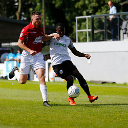 AUGUST 12:  Dover Athletic against Wrexham in Conference Premier at Crabble Stadium in Dover, England. Dover's midfielder Nortei Nortey tussles with Wrexham's midfielder Sam Wedgbury.  (Photo by Matt Bristow/mattbristow.net)