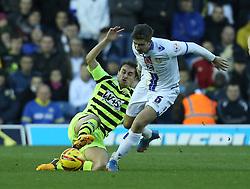 Yeovil Town's Edward Upson tackles Leeds United's Luke Murphy-Photo mandatory by-line: Matt Bunn/JMP - Tel: Mobile: 07966 386802 02/11/2013 - SPORT - FOOTBALL - Elland Road - Leeds - Leeds United v Yeovil Town - Sky Bet Championship