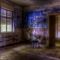 Empty room in old house with chair by window