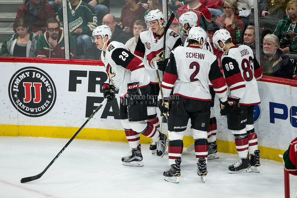 Dec 17, 2016; Saint Paul, MN, USA; Arizona Coyotes forward Brendan Perlini (29) celebrates his goal with teammates during the third period against the Minnesota Wild at Xcel Energy Center. The Wild defeated the Coyotes 4-1. Mandatory Credit: Brace Hemmelgarn-USA TODAY Sports