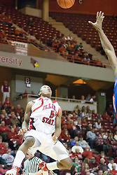 "02 December 2006: Keith ""Boo"" Richardson gives the alley-oop shot to get the ball over the defense. In a non-conference game, the Mavericks of University of Texas at Arlington lost to the Redbirds home 86-61. The win was the 5th in a row for the Redbirds, the longest winning streak in 6 years. the game was played at Redbird Arena in Normal Illinois on the campus of Illinois State University.<br />"