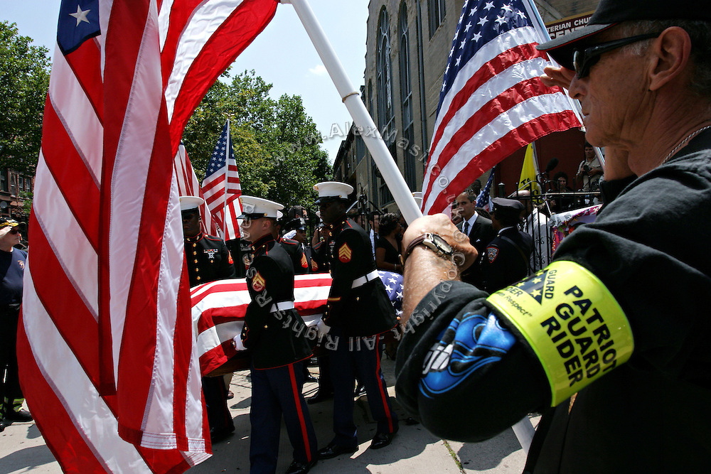 Members of the Patriot Guard Riders holding US flags while standing in front of the Bedsford Central Presbyterian church, during the passage of LCpl. Nicholas J. Whyteís coffin, in Brooklyn, New York, NY., on Friday, June 30, 2006. LCpl. Nicholas J. Whyte, a 21-year-old American serviceman died  on June 21, 2006, while conducting combat operations in Al Anbar province, Iraq. The Patriot Guard Riders is a diverse amalgamation of riders from across the United States of America. Besides a passion for motorcycling, they all have in common an unwavering respect for those who risk their lives for the country's freedom and security. They are an American patriotic group, mainly but not only, composed by veterans from all over the United States. They work in unison, calling upon tens of different motorcycle groups, connected by an internet-based web where each of them can find out where and when a 'Mission' is called upon, and have the chance to take part. This way, the Patriot Guard Riders can cover the whole of the United States without having to ride from town to town but, by organising into different State Groups, each with its own State Captain, they are still able to maintain strictly firm guidelines, and to honour the same basic principles that moves the group from the its inception. The main aim of the Patriot Guard Riders is to attend the funeral services of fallen American servicemen, defined as 'Heroes' by the group,  as invited guests of the family. These so-called 'Missions' they undertake have two basic objectives in particular: to show their sincere respect for the US 'Fallen Heroes', their families, and their communities, and to shield the mourners from interruptions created by any group of protestors. Additionally the Patriot Guard Riders provide support to the veteran community and their families, in collaboration with the other veteran service organizations already working in the field.   **ITALY OUT**