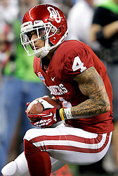 Oklahoma Sooners wide receiver Kenny Stills (4) catchs a pass for a first down during the 77th AT&T Cotton Bowl Classic between the Texas A&M University Aggies and the Oklahoma University Sooners at Cowboys Stadium in Arlington, Texas. Texas A&M wins the 77th AT&T Cotton Bowl Classic against Oklahoma, 41-13.