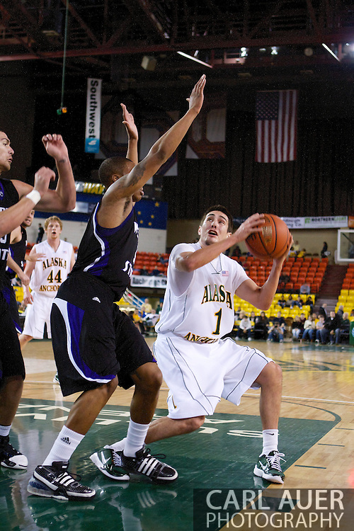 November 25th, 2010:  Anchorage, Alaska - University of Alaska-Anchorage guard Drew Robinson (1) pump fakes in the Seawolves 54-86 loss to Weber State in the first round of the Great Alaska Shootout.