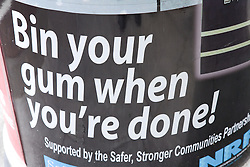 Clean up campaign wrap around a litter bin encouraging people to put chewing gum in the provided bin,