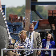 5/7/11 -- BATH, Maine. Ship Sponsor, Maureen Murphy Christens U.S. Navy Destroyer Michael Murphy on Saturday at Bath Iron Works. The 509 foot ship was named for Lieutenant Michael Murphy, whose bravery under fire in Afghanistan in June, 2005 led to his posthumous receipt of the Medal of Honor..The ceremony included speeches by Maine Governor Paul LePage, Chief of Naval Operations - Admiral Gary Roughead, Senator Olympia Snowe, Representatives Mike Michaud and Chellie Pingree as well as ship sponsor, Maureen and Dan Murphy, parents of Lieutenant Murphy. While the ship was not actually launched during the ceremony, it was rolled into the drydock and launched on Sunday morning at approximately 2:15 A.M in the Kennebec River.  Photo by Roger S. Duncan.