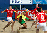 07 December 2006, Brazil's Andre Nascimento attempts a bicycle kick as the English players watch during the first game of the Vodacom Pro Beach Soccer Tour starts at Durban's Bay of Plenty on Thursday. Brazil won the game 10 - 3. Picture: Shayne Robinson, PhotoWire Africa