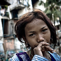A young woman in a Phnom Penh slum. Investigators later found her mother was pimping the drug-addicted girl nightly to upwards of 10 Cambodian men.