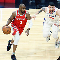 28 February 2018: Houston Rockets guard Chris Paul (3) drives past LA Clippers guard Austin Rivers (25) during the Houston Rockets 105-92 victory over the LA Clippers, at the Staples Center, Los Angeles, California, USA.