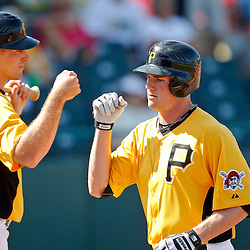 February 25, 2011; Bradenton, FL, USA; Pittsburgh Pirates infielder Brian Friday (77) celebrates Eric Fryer (80) after hitting a homerun during a spring training exhibition game against the State College of Florida Manatees at McKechnie Field. The Pirates defeated the Manatees 21-1. Mandatory Credit: Derick E. Hingle-US PRESSWIRE