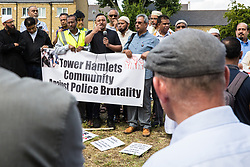 London, UK. 12 July, 2019. A member of the local community remonstrates with John Biggs (r), the Labour Mayor of Tower Hamlets, during a protest close to the site where Youness Bentahar, aged 38, was violently arrested by Metropolitan Police officers on 10th July following a 5-stage warning. The incident, during which Mr Bentahar appeared to be having a seizure, has since been referred to the Metropolitan Police's Central East Command Professional Standards Unit after a video of the arrest went viral on social media. Mr Bentahar was filmed being struck with handcuffs and pinned down by police officers after he had stopped on a single yellow line with a disabled badge displayed and ignored the five-stage warning.