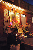 Mexico, Michoacan, Morelia. In the capital's working-class neighborhood of Mariano Escobedo, a group of neighbors builds a shrine to the Virgin of Guadalupe right on the street. To Mexico's many faithful, she is a powerful symbol of hope.