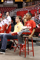 21 December 2015:  Ball Crew broom boy has a snack of hotdog and potato chips. Illinois State University Women's Basketball team hosted The Cougars of Chicago State at Redbird Arena in Normal Illinois.