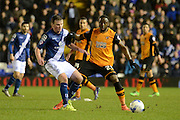 Birmingham City midfielder Stephen Gleeson plays the ball away from Hull City striker Adama Diomande during the Sky Bet Championship match between Birmingham City and Hull City at St Andrews, Birmingham, England on 3 March 2016. Photo by Alan Franklin.