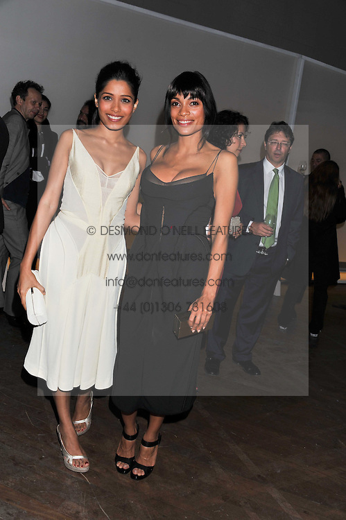 Left to right, FREIDA PINTO and ROSARIO DAWSON at a dinner hosted by Calvin Klein Collection to celebrate the future Home of The Design Museum at The Commonwealth Institute, Kensington, London on 13th October 2011.