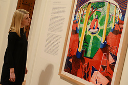 © Licensed to London News Pictures.04/02/2014. London, UK. A member of staff looks at David Hockney's lithograph 'Views of Hotel Well III' during a press view of the 'Hockney, Printmaker' exhibition in Dulwich Picture Gallery.The gallery celebrates 60 years of the British artist David Hockney's printmaking. Photo credit : Peter Kollanyi/LNP