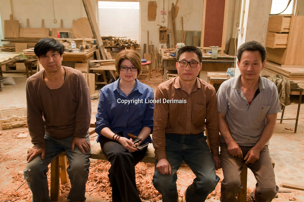 Lisa Minder and her team of master carpenters, Beijing, China.
