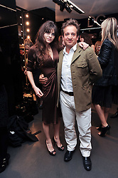 MARTHA FREUD and TOM FREUD at a party hosted by InStyle to celebrate the iconic glamour of Dolce & Gabbana held at D&G, 6 Old Bond Street, London on 3rd November 2010.