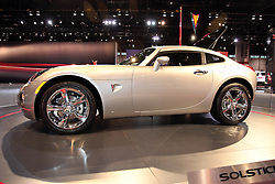 11 February 2009: 2009 Pontiac Solstice Sports Coupe - Reborn: 2009 PONTIAC SOLTICE COUPE: Drawing on the success of the convertible model, which is todayÕs top-selling roadster in the U.S., is theÔ09 Pontiac Solstice coupe. The coupeÕs roof is fixed aft of the B-pillars, with side windows and a rear liftglass for access to the cargo area. One person can remove the removable roof panel over the passenger compartment and the roof has a Òcarved outÓ inner contour that greatly enhances headroom, for a maximum of 37.4 inches. A home storage case for the roof panel is offered through GM Accessories. Two engines are available, with a standard 173 horsepower, 2.4-liter Ecotec 4-cylinder, and the GXP version is equipped with a 2.0L turbocharged Ecotec with 260 horsepower.. The Chicago Auto Show is a charity event of the Chicago Automobile Trade Association (CATA) and is held annually at McCormick Place in Chicago Illinois.