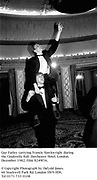 Guy Farley carrying Francis Hawkwright during the Cinderella Ball. Dorchester Hotel. London. December 1982. Film 8249f16.<br />