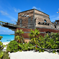 On The Rocks Pirate Ship Bar at Half Moon Cay, Bahamas <br /> This full-sized, wooden pirate ship looks like it was beached after losing a battle against the Spaniards.  It actually houses &ldquo;On The Rocks,&rdquo; the largest bar on Half Moon Cay.  Inside the schooner is a full-service tavern where you can relax with great views of the beach and lagoon while listening to calypso music.