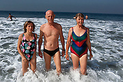Biosphere 2 Project undertaken by Space Biosphere Ventures, a private ecological research firm funded by Edward P. Bass of Texas.  Dr. Roy Walford, former pathologist at UCLA and one of the eight inhabitants of the Biosphere, seen in the Pacific Ocean with girlfriend Barbara Smith and his daughter Lisa at Venice Beach, California. Walford authored a book titled The Anti-Aging Plan. He died in 2004 at age 79 of ALS. Walford had been involved in the Project since 1983, and set up the Biosphere's medical centre.  Biosphere 2 was a privately funded experiment, designed to investigate the way in which humans interact with a small self-sufficient ecological environment, and to look at possibilities for future planetary colonization. MODEL RELEASED 1990