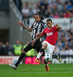 NEWCASTLE, ENGLAND - Tuesday, April 19, 2011: Manchester United's Nani and Newcastle United's Jonas Gutierrez during the Premiership match at St James' Park. (Photo by David Rawcliffe/Propaganda)
