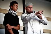 Frankfurt am Main | 07.05.2011..Am Samstag (07.05.2011) trat der radikalislamische salafistische Prediger Pierre Vogel (Abu Hamza) auf dem Rebstock-Gelaende in Frankfurt am Main bei einer Vortragsveranstaltung vor etwa 500 vorwiegend jungen Menschen auf. um ueber Islam und Terrorismus zu sprechen. Hier: Vogel (r) mit einem jungen Mann, der waehrend der Veranstaltung die Shahada (Glaubensbekenntnis des Islam) gesprochen hatte und den islamischen Glauben angenommen hat...©peter-juelich.com..[No Model Release | No Property Release]