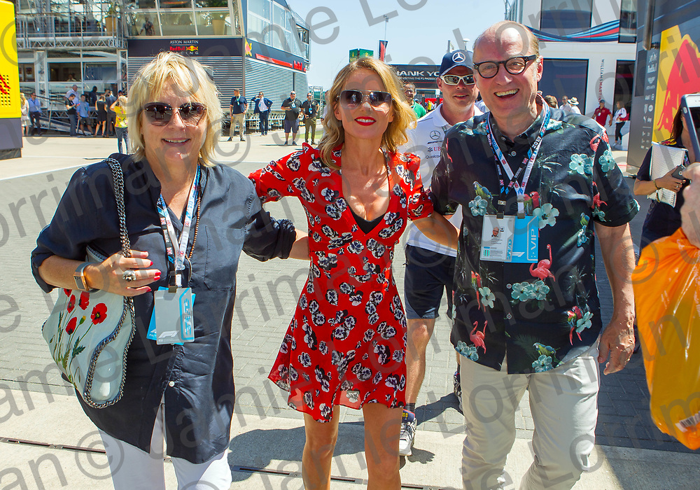 The 2018 Formula 1 F1 Rolex British grand prix, Silverstone, England. Sunday 8th July 2018.<br /> <br /> Pictured: Comedy couple Ade Edmondson and Jennifer Saunders pose with spice girl Geri Horner as they walk through the paddock ahead of the race at Silverstone.<br /> <br /> Jamie Lorriman<br /> mail@jamielorriman.co.uk<br /> www.jamielorriman.co.uk<br /> 07718 900288