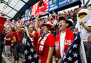 Fans get fired up before the start of the 2014 World Cup qualifier soccer match between the USA and Jamaica at Sporting Park in Kansas City, Kan., Friday, Oct. 11, 2013. (AP Photo/Colin E. Braley)