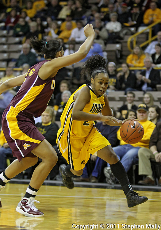 February 10 2011: Iowa Hawkeyes guard Kachine Alexander (21) drives around Minnesota Golden Gophers forward Kionna Kellogg (5) during the first half of an NCAA women's college basketball game at Carver-Hawkeye Arena in Iowa City, Iowa on February 10, 2011. Iowa defeated Minnesota 64-62.