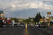 PINEDALE, WY - The busy streets of the no-stoplight-town of Pinedale, Wy.,  (pop. 1400) on August 10, 2005, where the county assessor states average 2004 home sales were $200,000 and 2004 north Sublette county sales averaged $275,000. Sublette County has 6400 permanent residents. Farms and ranches are being broken up and sold typically as two, five, 10, and 20 acre lots on septic systems and well water. One of the local sayings is that the escalating real estate prices are a result of the billionaires moving into nearby Jackson, WY, who are pushing out the millionaires who then move to Pinedale. According to realtor Travis Bing, anything one 'would want to buy' starts at about $200,000 with many homes selling for $450,000 and up. Pinedale currently has the lowest unemployment rate in the state and is experiencing another boom cycle both in real estate and in energy as natural gas production in two nearby gas fields ramps up for year-round production.