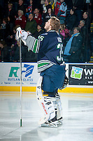 KELOWNA, CANADA -FEBRUARY 10: Taran Kozun #35 of the Seattle Thunderbirds stands on the ice during the national anthem against the Kelowna Rockets on February 10, 2014 at Prospera Place in Kelowna, British Columbia, Canada.   (Photo by Marissa Baecker/Getty Images)  *** Local Caption *** Taran Kozun;